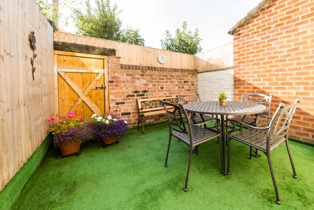 Lovely walled courtyard with seating and seasonal flowers, relax and enjoy and glass of Vino