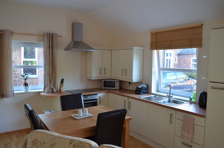 Kitchen / dining area with oven, hob, fridge (no freezer, washing machine or dryer), microwave, toaster, kettle, crockery, cutlery, and utensils