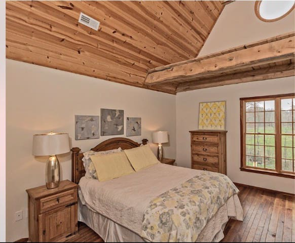 Master bedroom with adjustable base bed and Intellibed mattress. Dark out curtains have been added to windows.