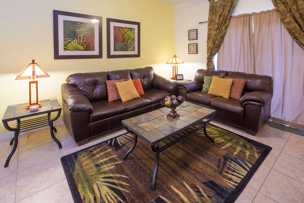 This condo enjoys a spacious family living area that opens on to the screened patio and includes a sitting area.