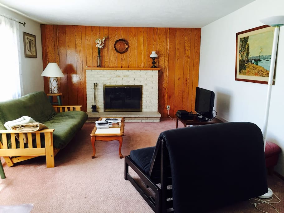 Living room with cable TV.  Potential room for extra guests in your party.