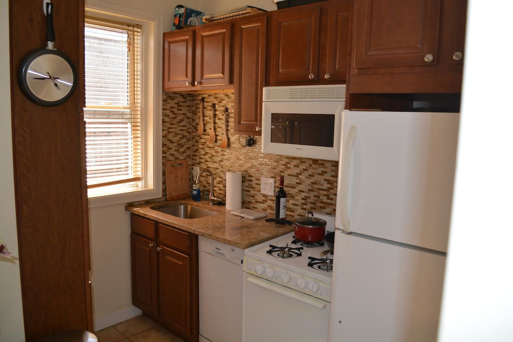 Kitchen with gas stove, dishwasher, and fully stocked with everything you'll need to cook with.
