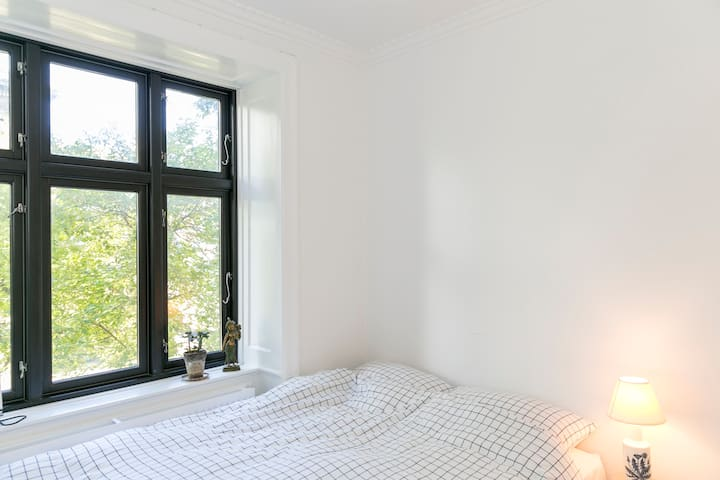 The bedroom with fluffy pillows and a huge duvet
