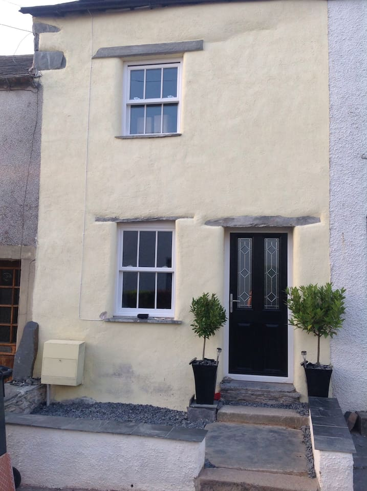 Lime render and slate exterior