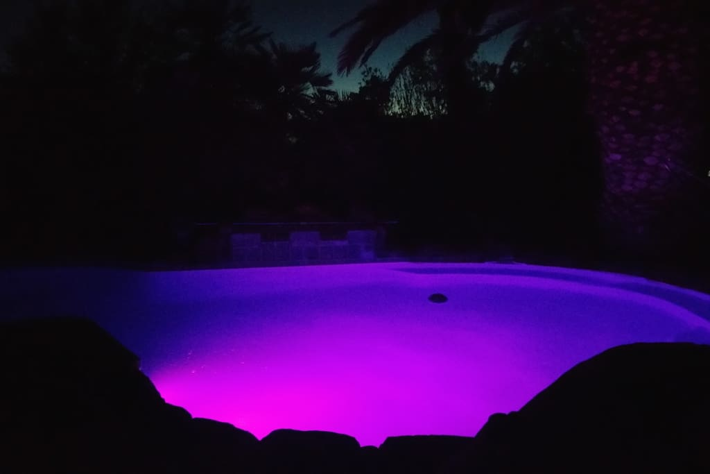 Swimming pool at night has color changing LED lights!