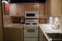 Kitchen includes fridge, oven, microwave, dishwasher, all utensils