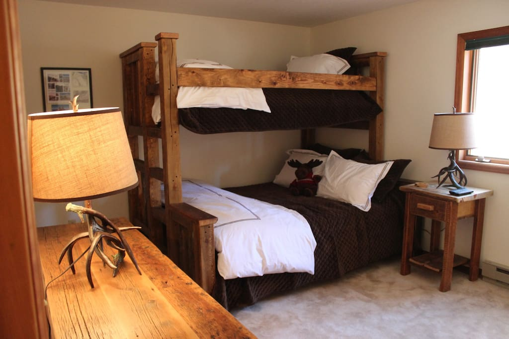 Bedroom has  Twin over Queen Bunk Bed that can sleep 3 people.  We can add an Airbed for additional guests with an extra charge.