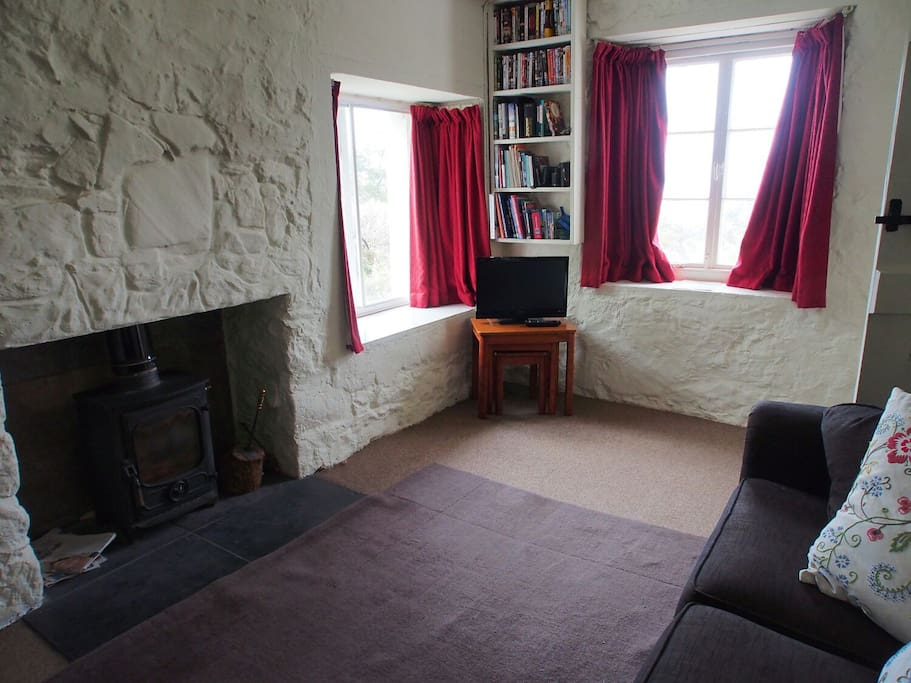 The Snug with wood burning stove.