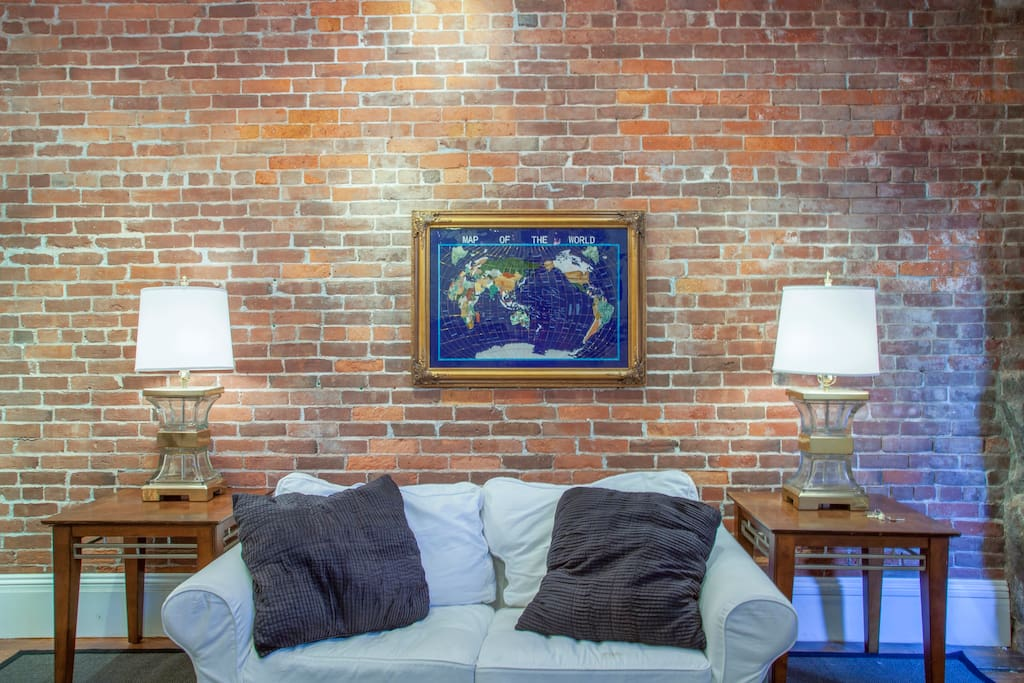 Cozy sitting area, with exposed brick
