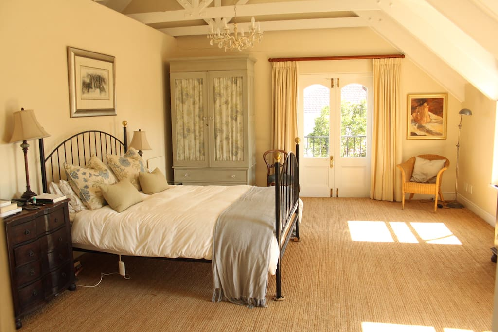 Light, spacious main bedroom with dressing room and en suite and view of Table Mountain