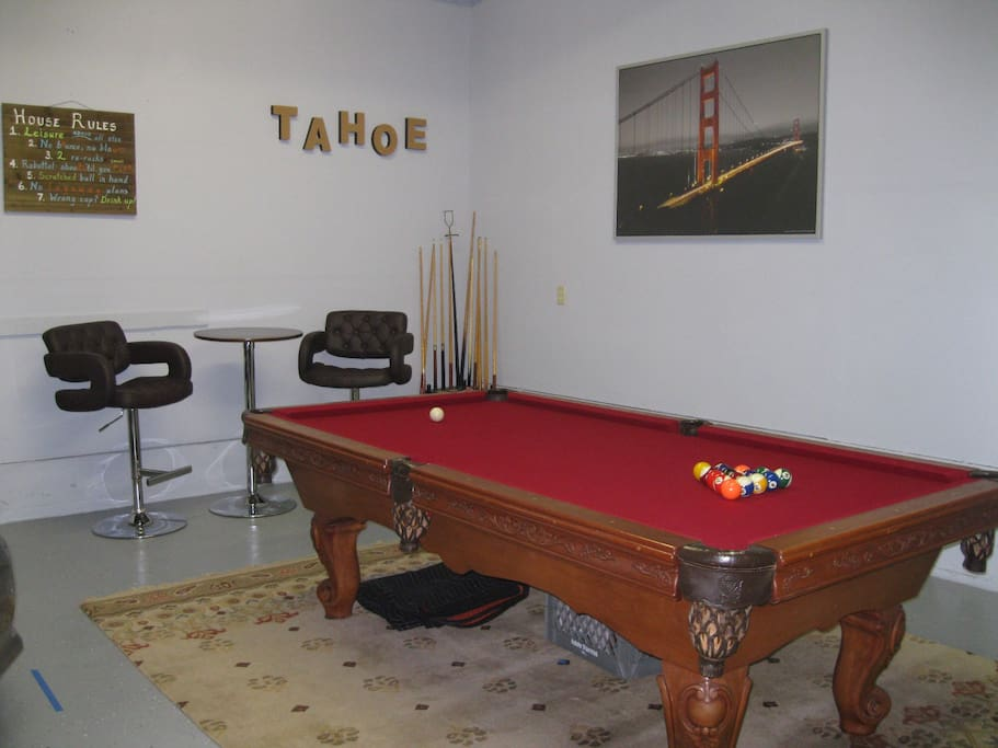 Garage converted into Game Room; pool table, darts, and ping pong.