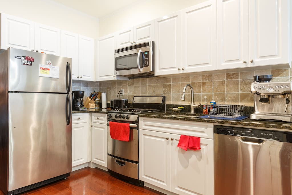 Kitchen includes stainless steel appliances, microwave and dishwasher