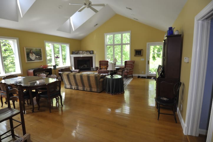 Large, bright family room with breakfast table.
