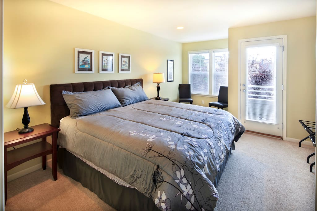 Master bedroom and private balcony with view of downtown
