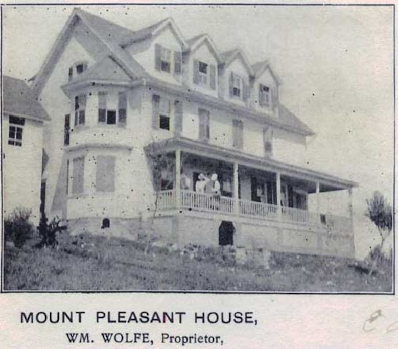 Old photo of the Main House from the early 1900s.