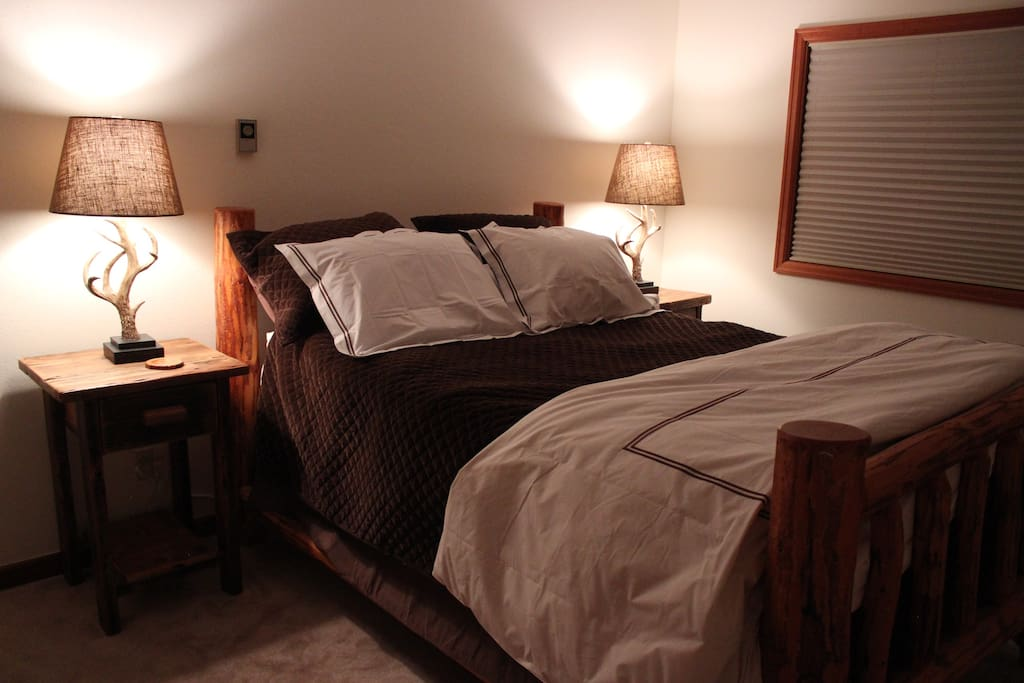 This large bedroom has a queen bed that will accommodate 2 people.