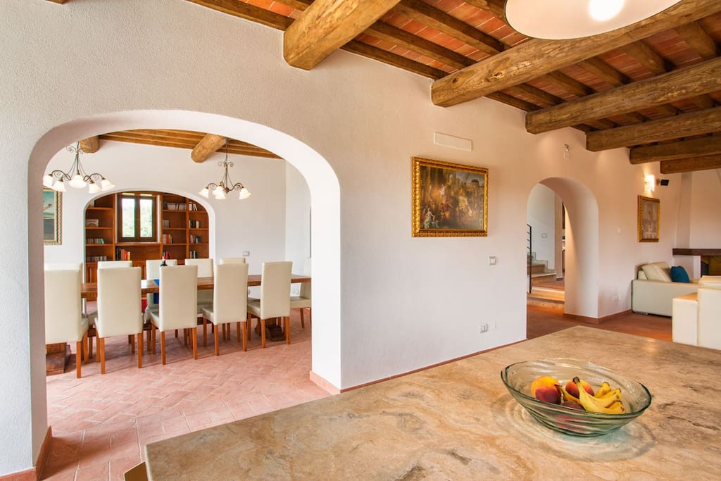 Traditional Tuscan ceilings and floors with modern amenities and furnishings