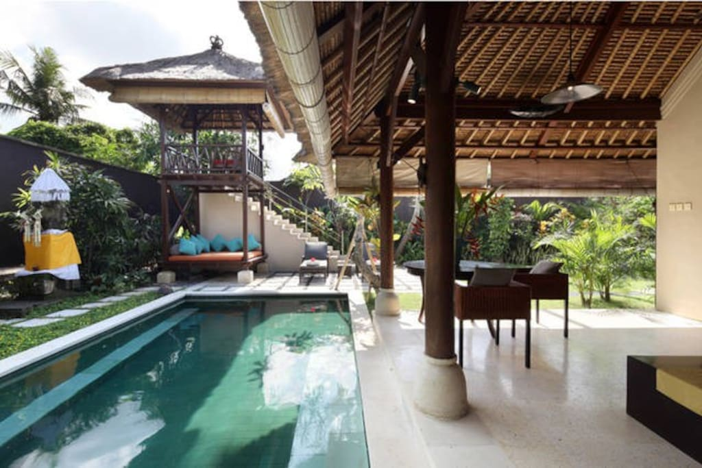 Daybed, private pool, and elevated covered deck overlooking our mango orchard and village rooftops.