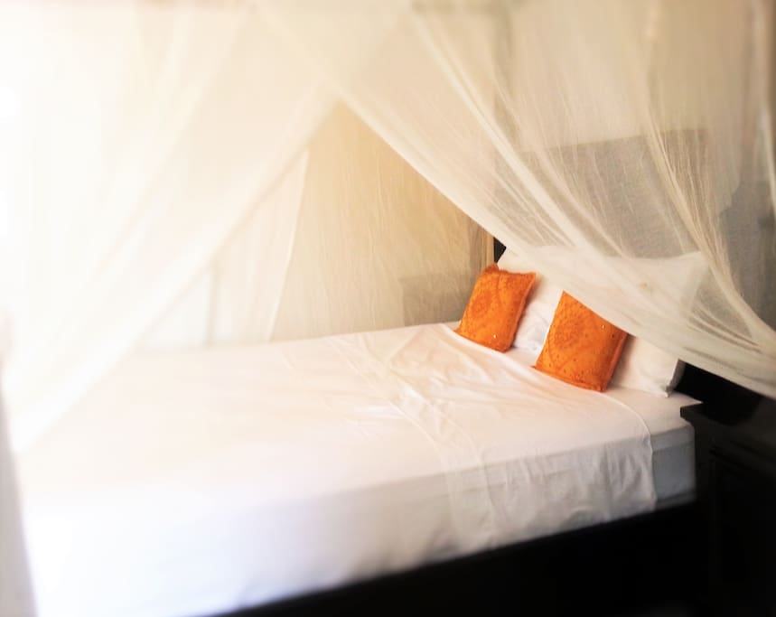 Comfortable queen sized four poster bed