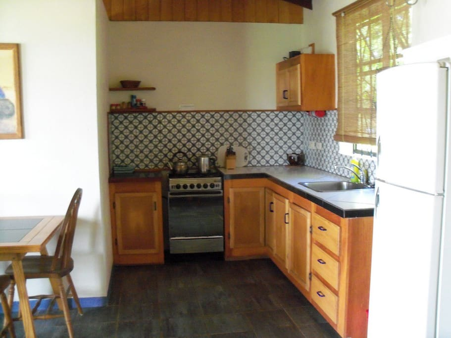 The fully equipped kitchen makes meal preparation  an easy vacation option.