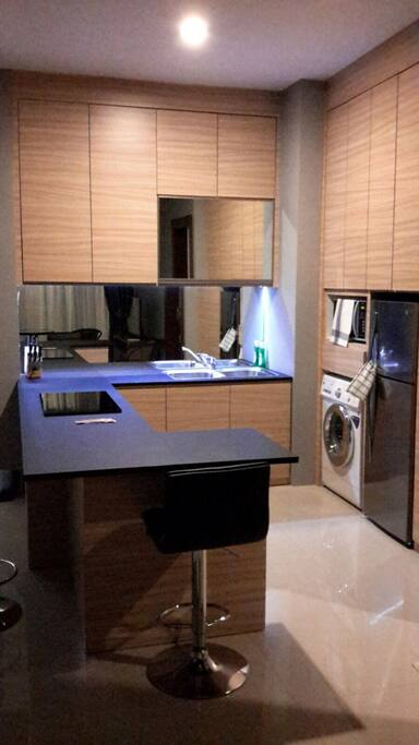 Fully equipped kitchen with oven, micro, induction hob, fridge and all small appliances