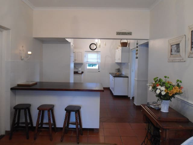 View of open plan entrance hall/kitchen with breakfast nook