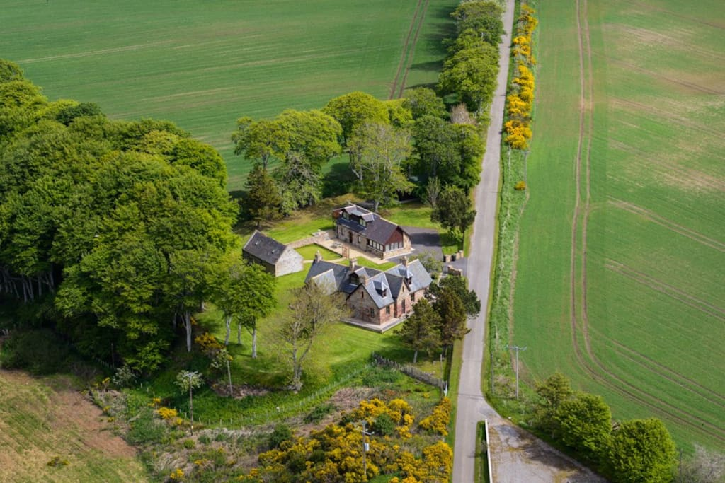 Aerial image of Mount Canisp house, with Swallow Cottage and Outbuilding in the background.