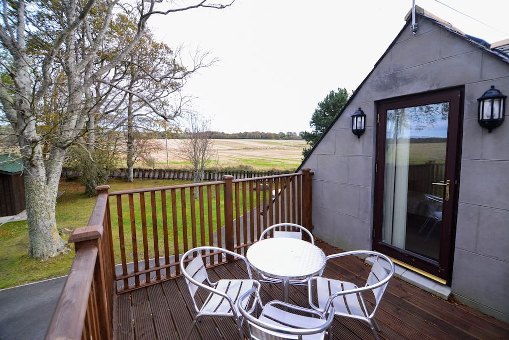 Upstairs bedroom  leads out onto an elevated wooden balcony; a great spot for alfresco dining or an evening drink enjoying gorgous views over the surrounding countryside.