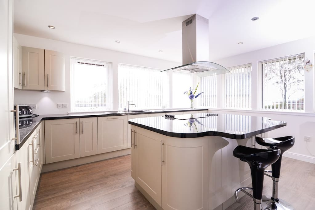 Stunning modern kitchen wirth views of the surrounding garden and countryside.