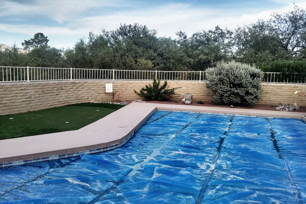 lap pool and putting green, pool is salt water pool