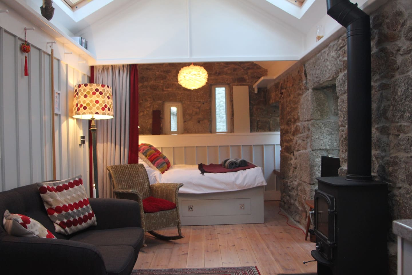 The Studio Interior - large double bed with a curtain to separate it from the living room