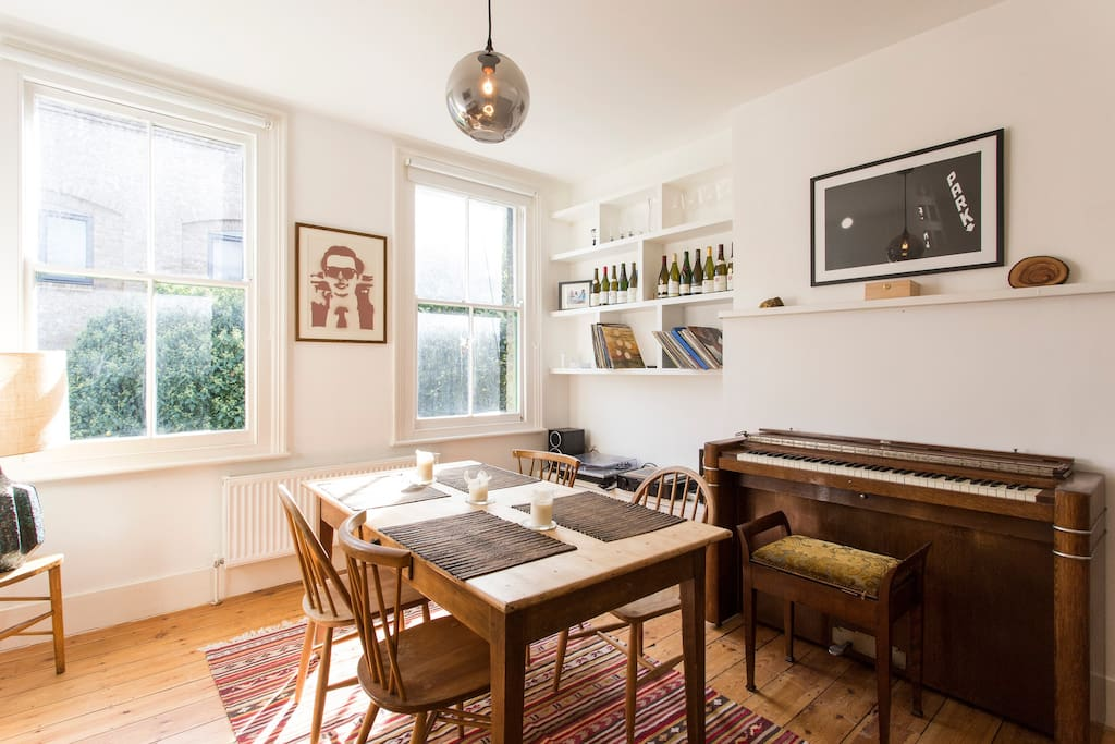 record player and piano in the dining room,...