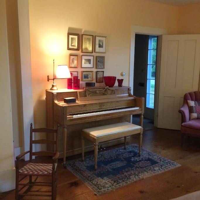 Piano available for guests in the living room, and an antique pump organ in the front hall for mature players.