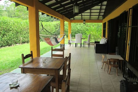 Casa Corazon features a large roofed terrace with dining area, hammocks and outdoor living room to enjoy the view of The Cahuita National Park.   It is only a 10 minute walk and a 3 minute drive to the white sand beaches of the Cahuita National Park