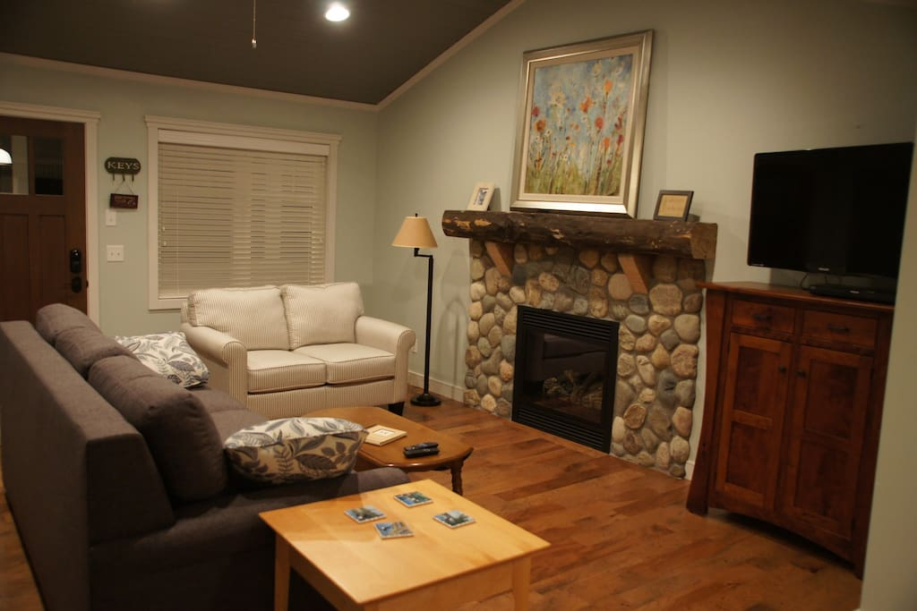 Cozy gas fireplace and cottage style detailing.   Not a cabin, but a peaceful stylish retreat.