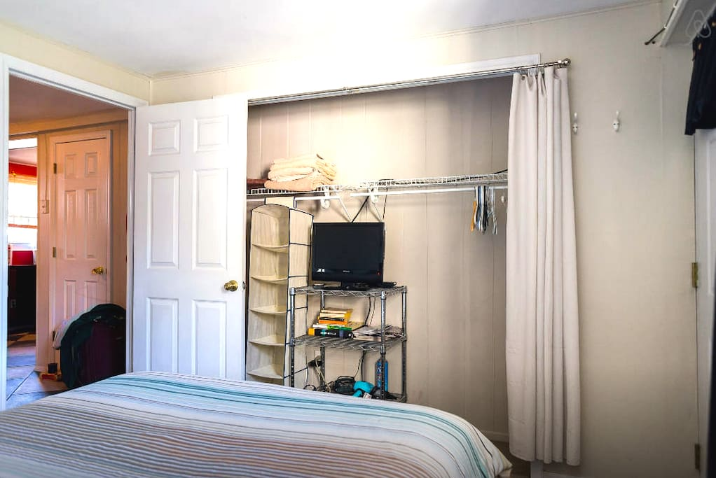 Closet / TV area at foot of the bed.
