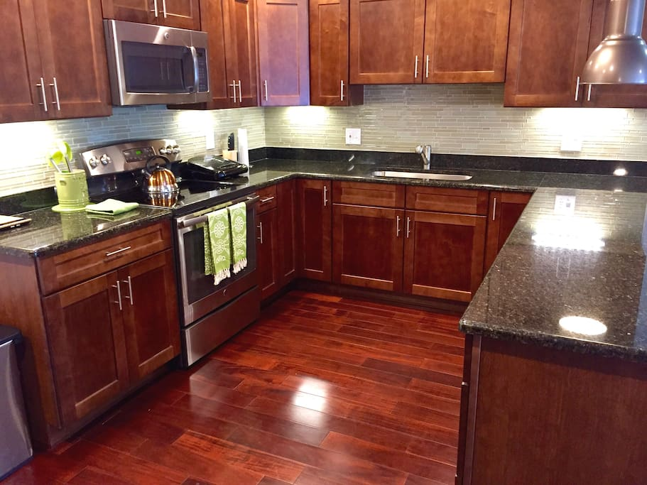 Brand new kitchen appliances and real wood floor.