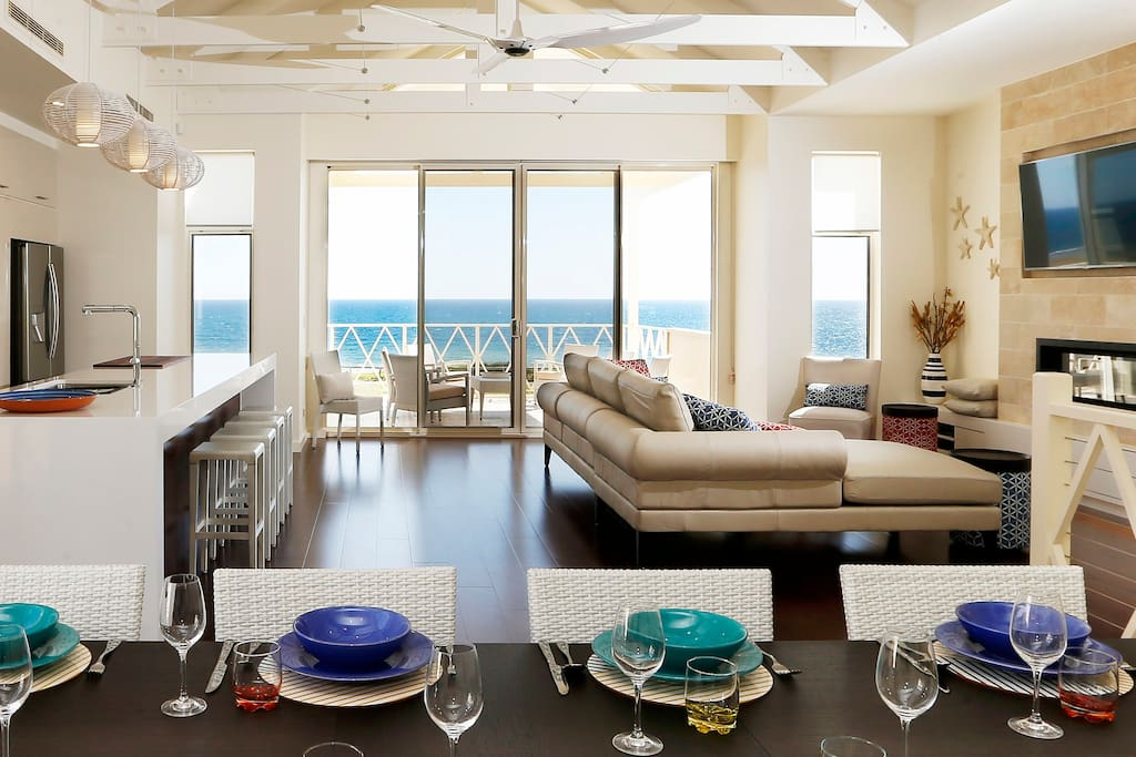 Entertain in the large open plan living area with seafront balconies & superb views.