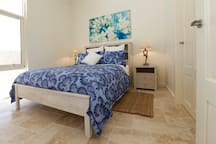 Queen size bedroom with oceanfront views and ensuite facilities