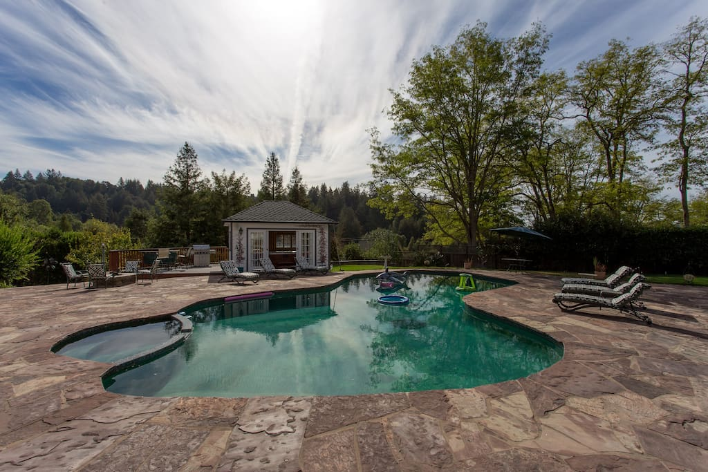 Enjoy the serene and peaceful backyard views, notice the private gazebo that houses the hot tub as well as the new large BBQ grill/fire pit.