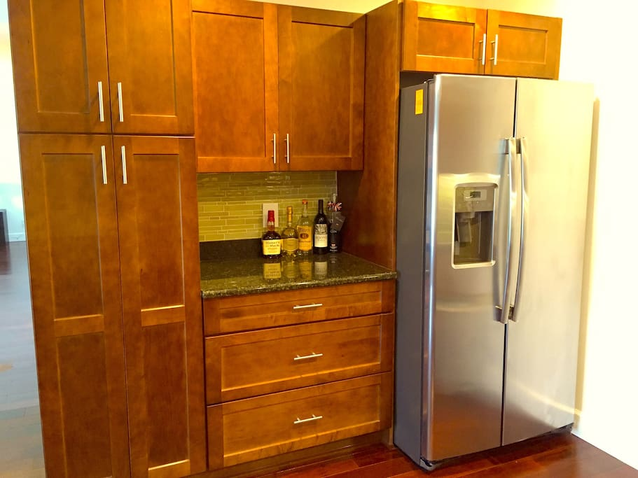 Wet bar area and large fridge/freezer.