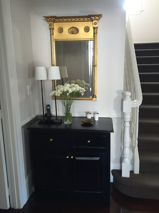 Staircase leading to three bedrooms and two bathrooms upstairs.