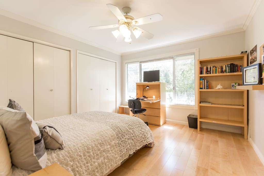 Freshly painted with gleaming maple hard wood floors, Visio TV. pull out desk and chair