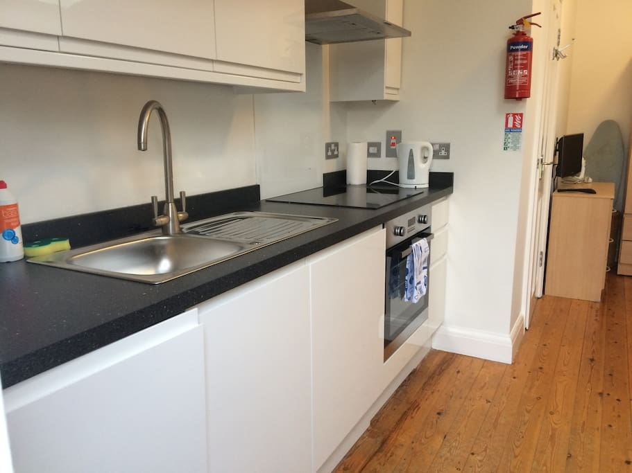 Fully equipped kitchen with fridge, oven and hob