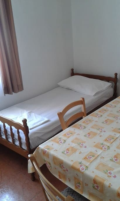 Bed in livingroom with kitchen