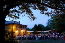 A wedding dinner in front of the villa with around 100 guests (in 2 tables).