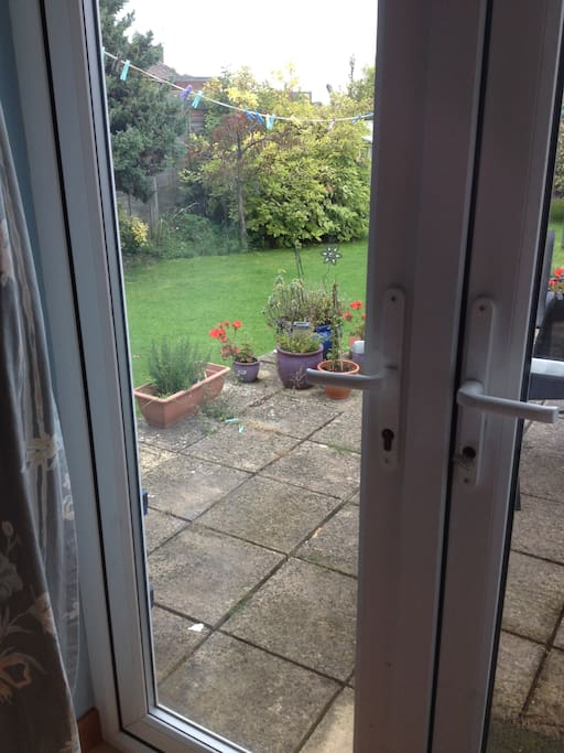 French doors from the bedroom to the garden.