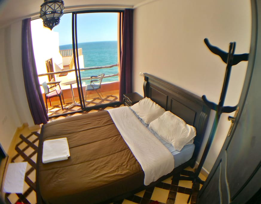 Fish eye view of the room, straight out ahead is the ocean, to the left is the ensuite. Behind is direct access to the hall and street.