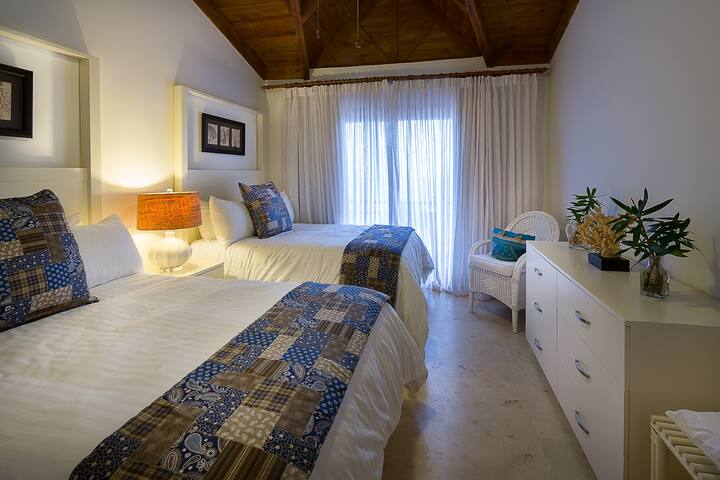 Your evenings are sure to be restful in our second bedroom which is equipped with two ultra-plush full size beds, en-suite bathroom, and yet another breathtaking view of the ocean from the balcony