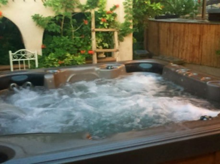 Enjoy a private hot tub under the stars.